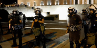 Greek protesters clash with police over COVID-19 vaccines