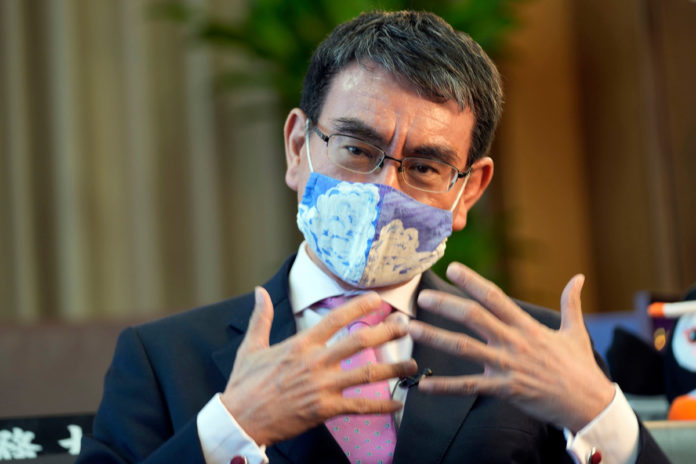 Japan minister urges vaccines for young