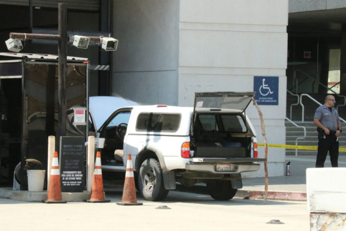 Man in body armor, loaded with guns stopped from entering LA court