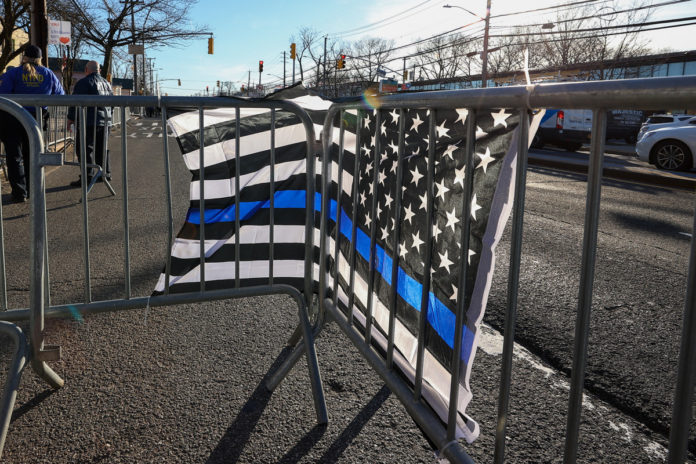 Student charged with hate crime for destroying pro-cop sign