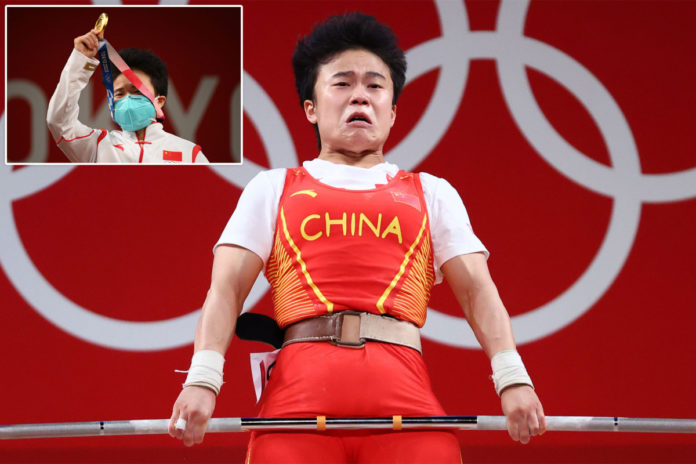 Chinese diplomats furious over photo of weightlifting gold-medalist
