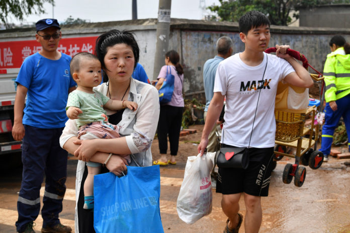 China evacuates tens of thousands as storms spread north