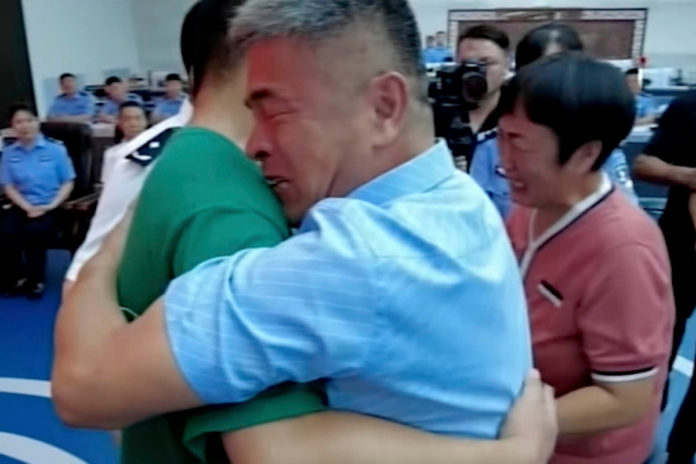Father reunited with abducted son 24 years later in China