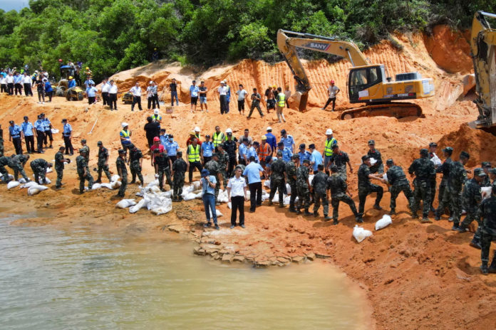 Flood traps 14 construction workers in tunnel under Chinese reservoir