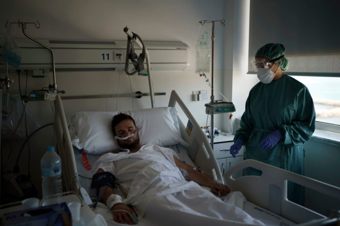 Younger patients flood Spanish hospitals amid new COVID surge
