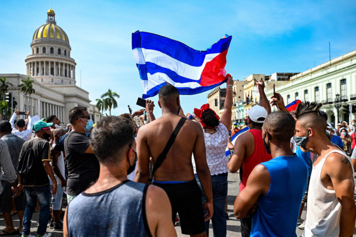 Cubans take to the streets in massive anti-government protest