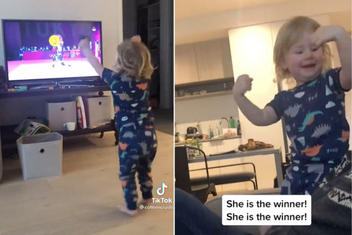 Adorable tot cheers on Olympic women weightlifters in viral clip