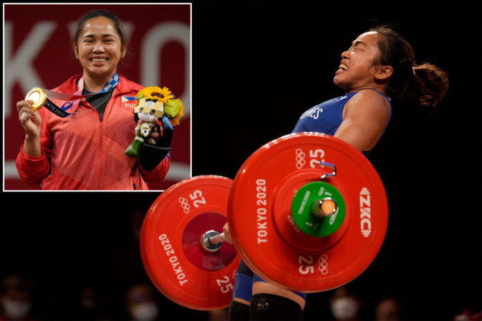 Filipino weightlifter gets $660K, 2 houses, free flights for gold
