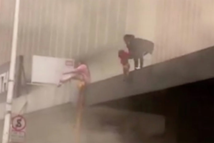 Mom drops 2-year-old daughter to safety from burning building in South Africa