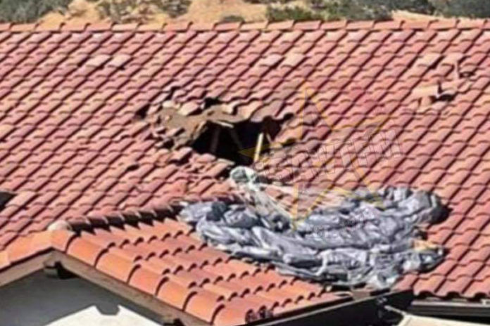 Parachuter plunges through roof and into California house