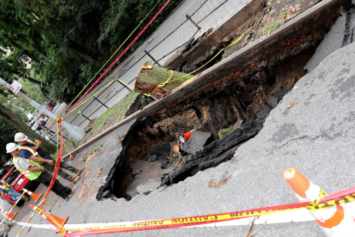 Sinkhole nearly swallows two cars on NYC's Upper West Side