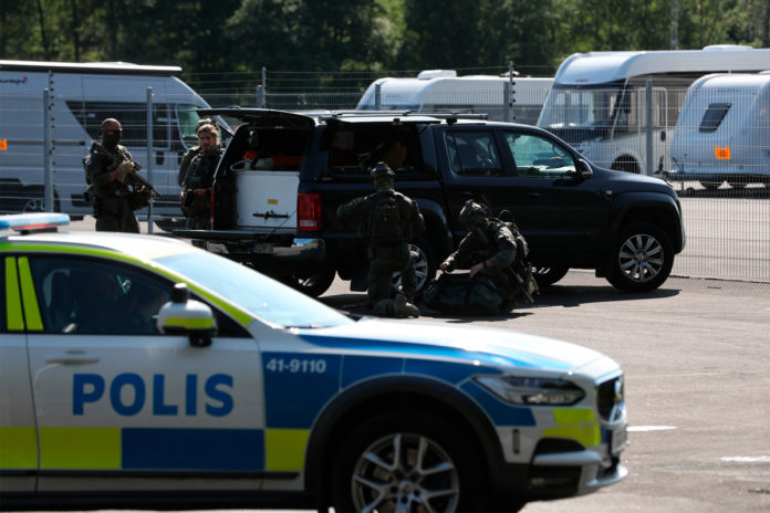2 guards taken hostage by inmates at prison in Sweden