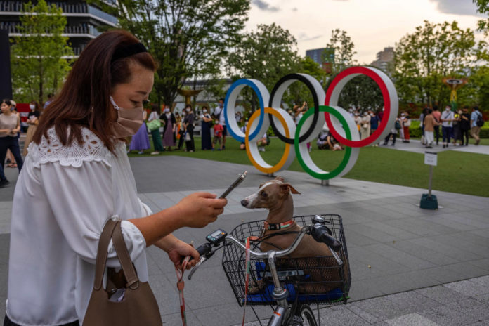 New COVID-19 cases surge in Olympic Village, across Tokyo