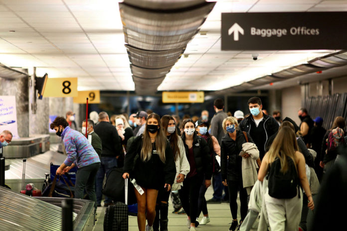 US not lifting foreign travel restrictions, White House says