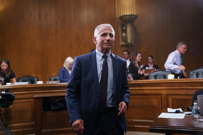 Public trust remains high in vaccines but slips for Fauci: poll