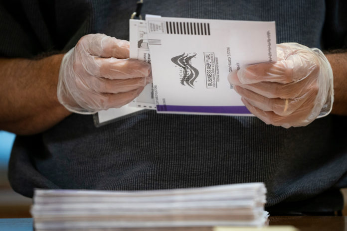DOJ may sue states for returning to pre-COVID voting laws