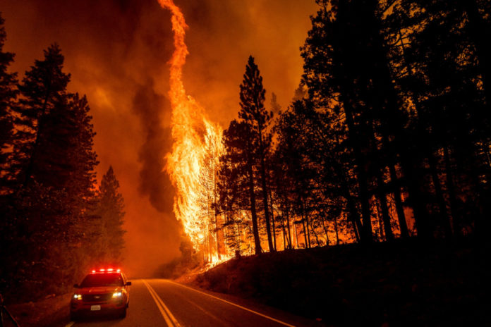 Huge California fire grows as heat spikes again across state