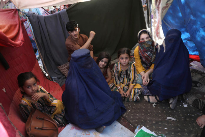 Afghanistan woman's rights activist fights back, refuses to wear the burqa
