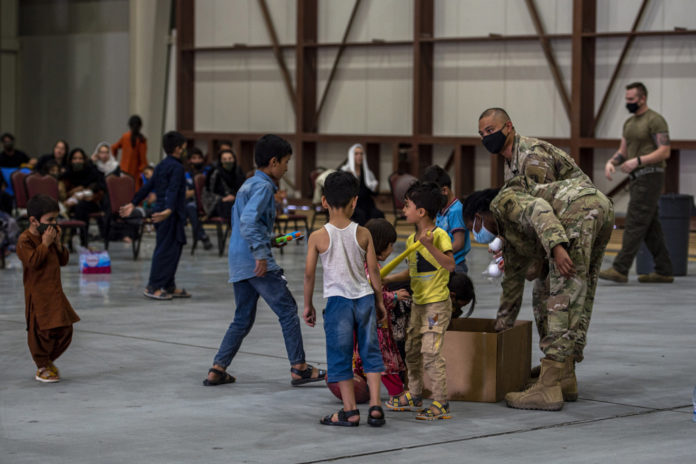 Where are Afghan refugees who were evacuated being taken?