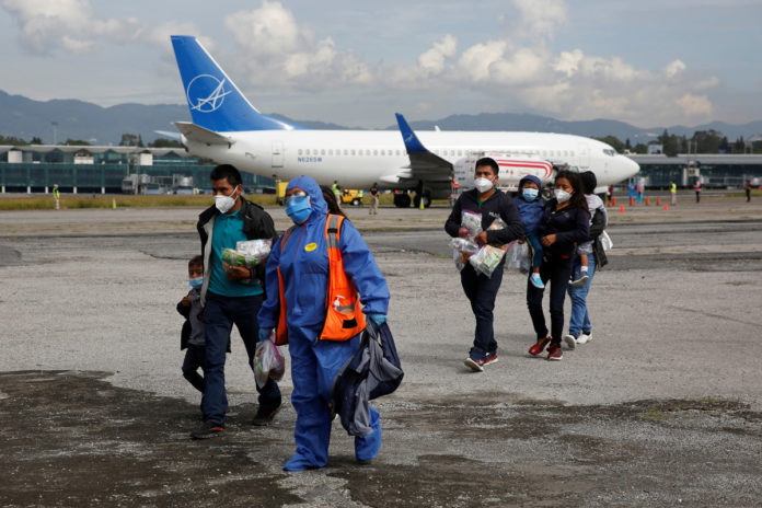 US flying migrants turned away by COVID protocol into Mexico