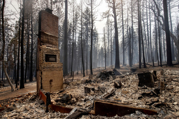 Fueled by winds, largest wildfire moves near California city