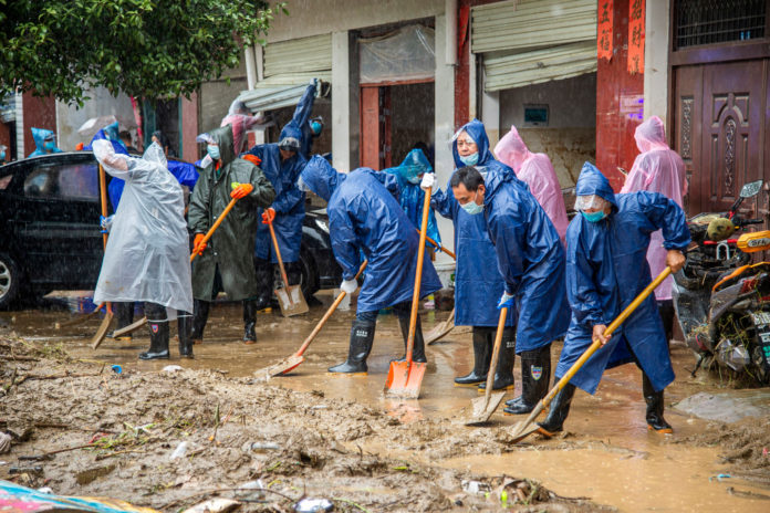 Fresh flooding in central China kills another 21 people