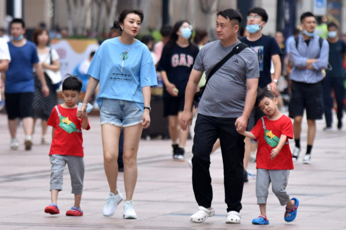 China changes law to allow married couples to have 3 kids