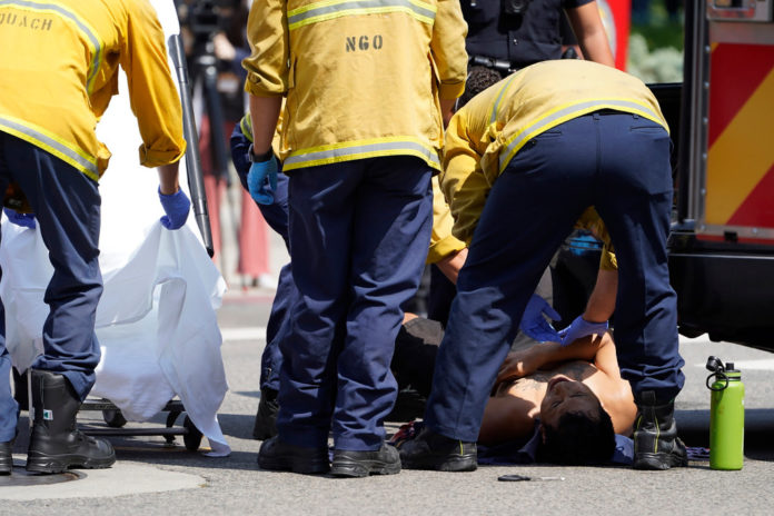 LAPD assists a man who was stabbed in a clash between anti-vaccination protesters and counter-protesters.