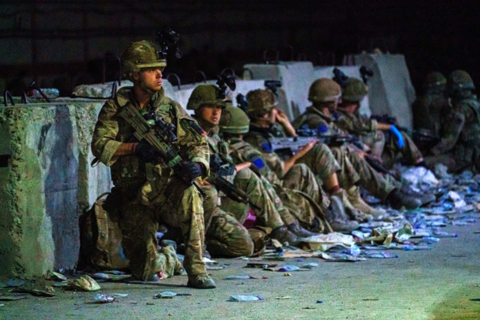 British soldiers secure the perimeter outside the Baron Hotel, near the Abbey Gate, in Kabul, Afghanistan on Aug. 26, 2021.
