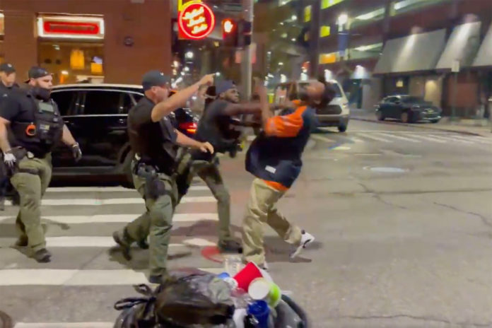 Detroit cop knocks out unarmed man with a punch to the face