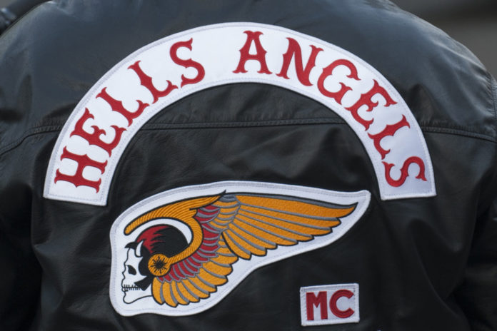 Doctor awaiting fraud trial accused of trying to hire Hells Angels to kill witness
