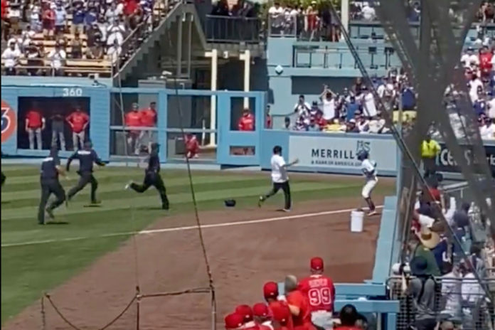 LA Dodgers ball girl takes down fan who ran on the field during game