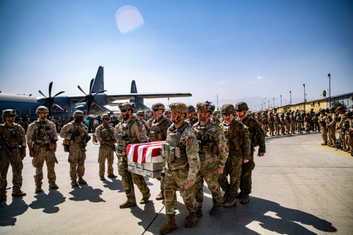 United States service members carrying the casket for a soldier who died in the terror attack at Hamid Karzai International Airport in Kabul on August 27, 2021.