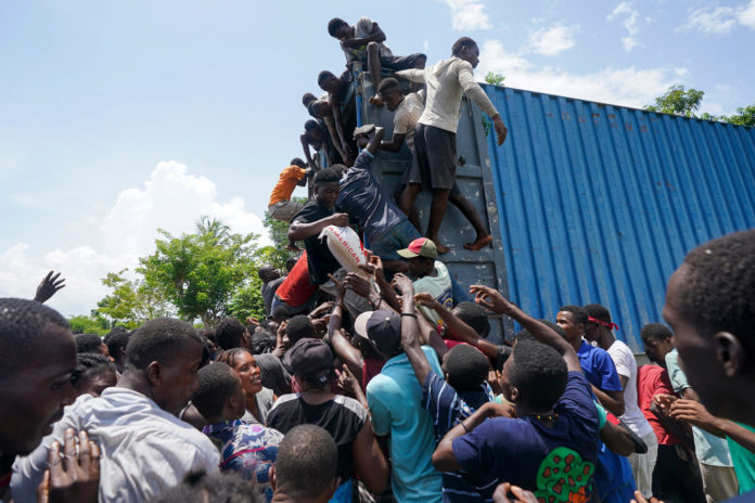 Haitians attack relief trucks, steal food after earthquake