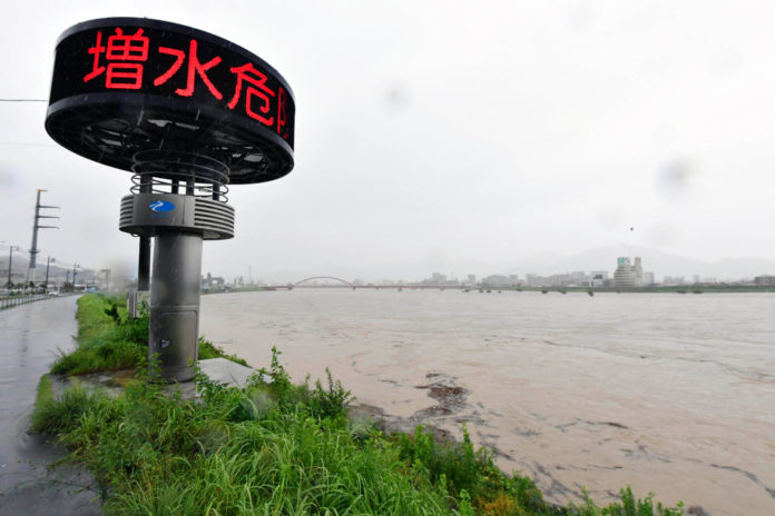 Japanese government urges two million to evacuate amid torrential rainfall