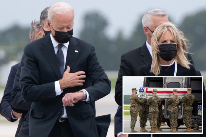 Biden ripped for apparently looking at watch at troops' ceremony