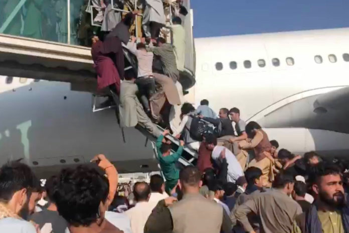 Shots fired at Kabul airport as Afghans try to flee Taliban