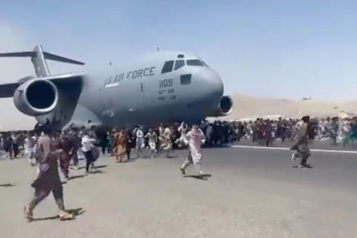 Afghans cling to US Air Force plane as it takes off in Kabul