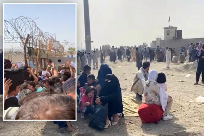 Afghan moms throw babies over barbed wire to UK troops at airport