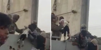 Afghan child hoisted over over wall amid Kabul airport chaos