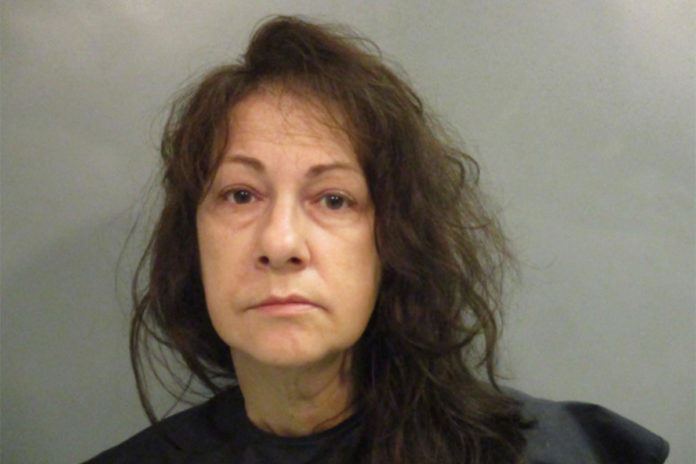 Woman left dead mom wrapped in newspaper, slept in same house, cops say