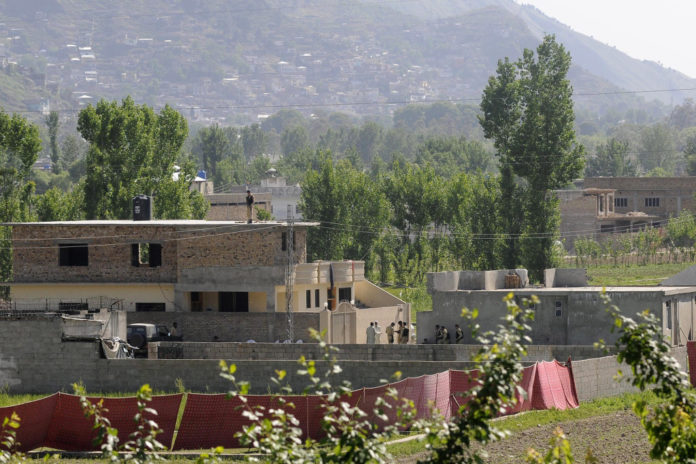 Pakistani Army soldiers secure the compound where Al-Qaeda leader Osama Bin Laden was killed by US military forces in Abbotabad, Pakistan.