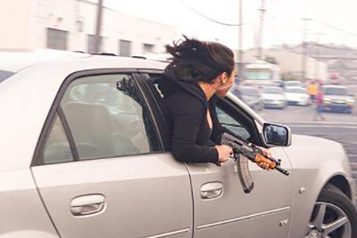 Woman seen leaning out of car holding AK-47 in San Francisco