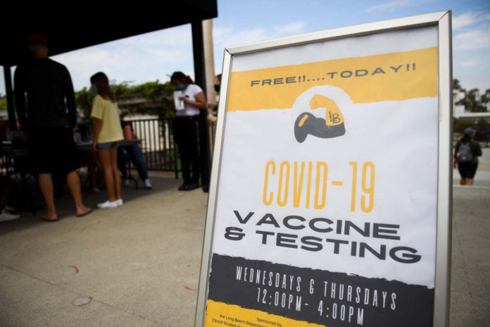Man drives car into workers at California COVID vaccination clinic