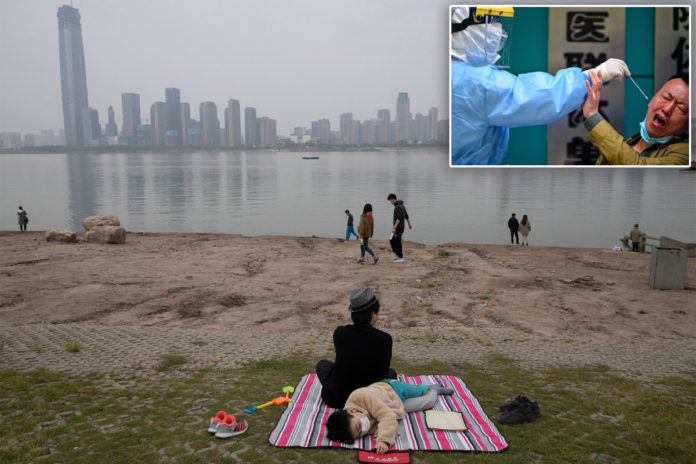 Wuhan to test all residents for COVID-19 as local infections return