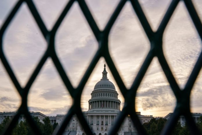 Capitol gets fencing around it ahead of anticipated protest