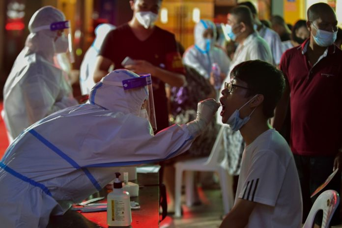 China imposes local lockdowns as COVID-19 cases surge