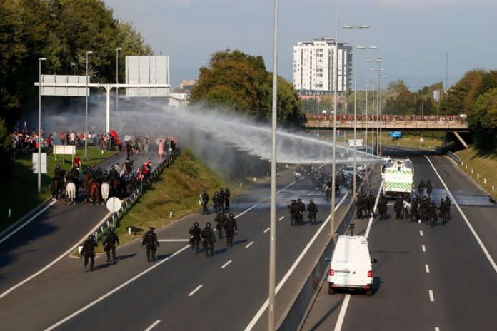Slovenia police use water cannons at anti-COVID pass protest