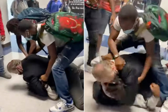 Teacher seen in student fight allegedly 'grabbed' another in 1999