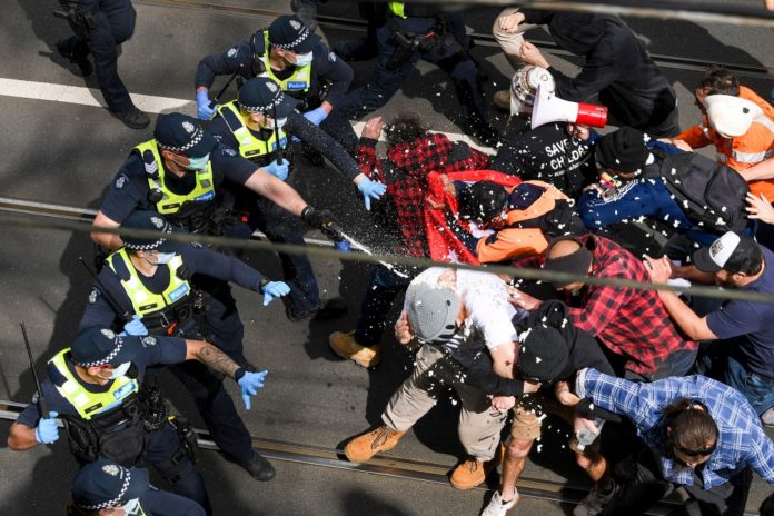Australian police clash with anti-lockdown protesters, arrest nearly 270